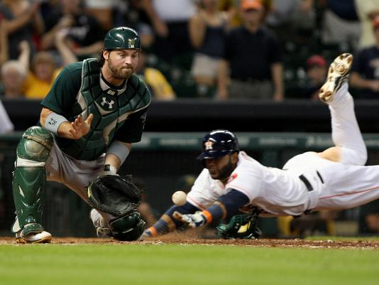 JONATHAN VILLAR SLIDES HOME WITH THE WINNING RUN AS THE ATHLETICS FALL  COUGH ONE UP TO ASTROS d7a2cb6fa
